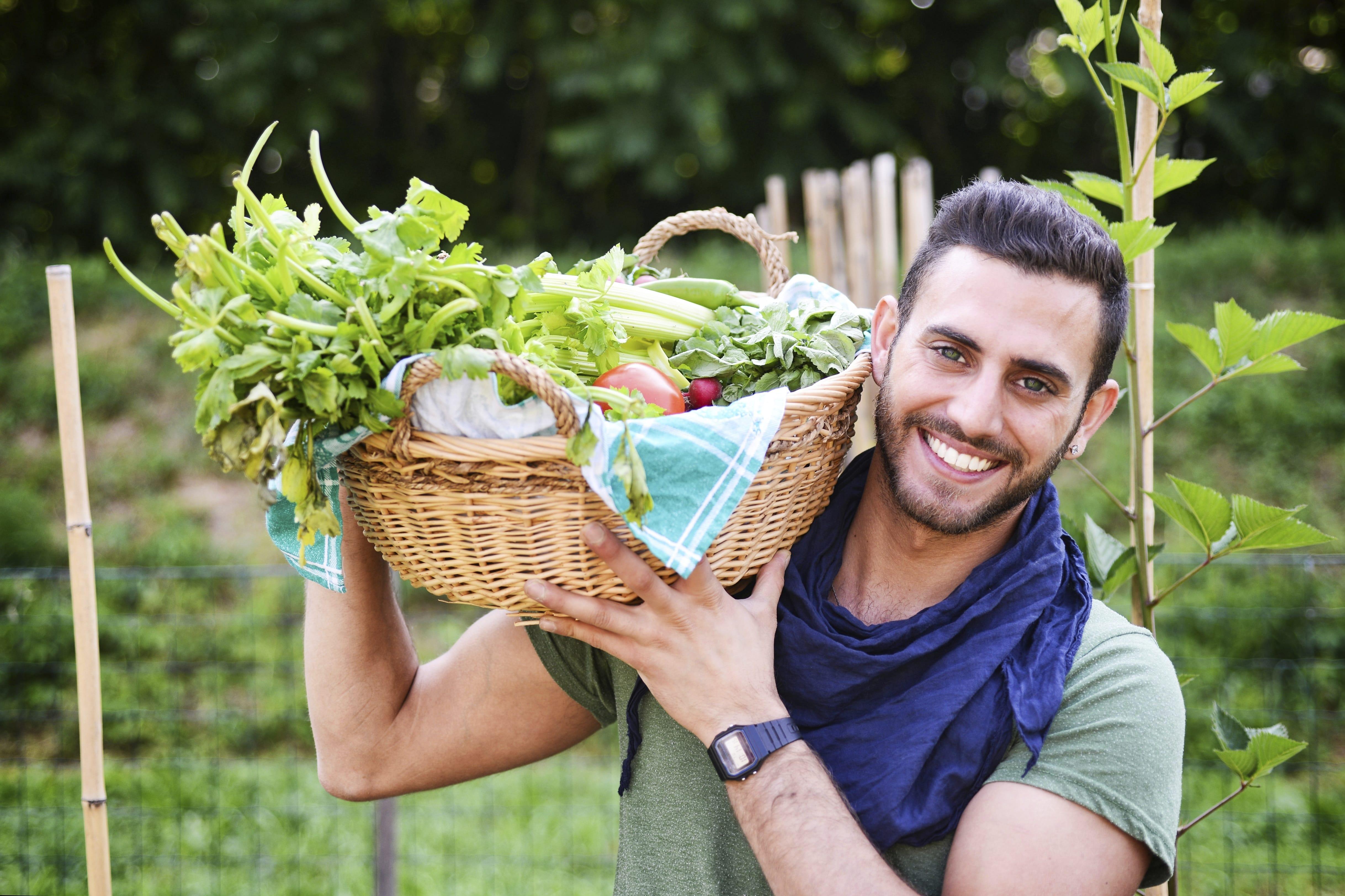 man_in_garden_with_basket
